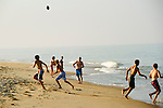 A family enjoys an evening game of football on the beach during their vacation in the Outer Banks town of Duck, North Carolina.  Duck is located on the north end of the Outer Banks and has experienced exponential growth over the past ten years. Duck is now a thriving year-round town as well as vacation destination. (Photo by Artisan Photograhy Group/Chris English)