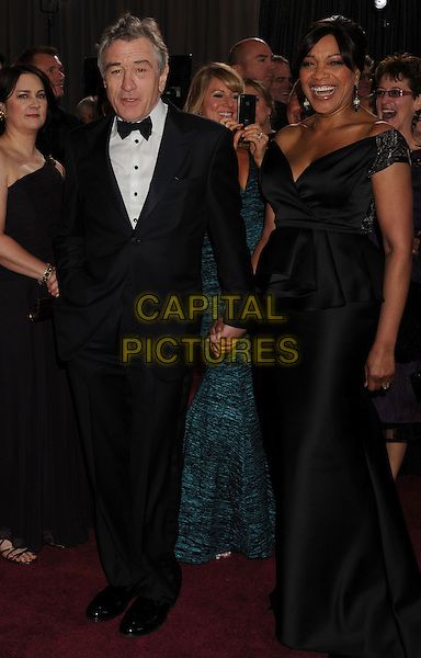 Robert De Niro and Grace Hightower.85th Annual Academy Awards held at the Dolby Theatre at Hollywood & Highland Center, Hollywood, California, USA..February 24th, 2013.oscars full length black tuxedo dress off the shoulder married husband wife peplum.CAP/ROT/TM.©Tony Michaels/Roth Stock/Capital Pictures