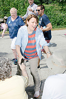 Democratic presidential candidate and Minnesota senator Amy Klobuchar greets people as she marches in the 4th of July parade in Amherst, New Hampshire, on Thu., July 4, 2019.