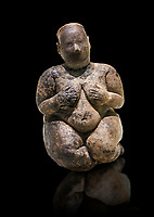 Seated terracotta goddess, probably a sign of fertility. Catalhoyuk Collections. Museum of Anatolian Civilisations, Ankara. Against a black background