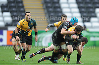 Northampton Saints Jamie Elliott is tackled by Ospreys Justin Tipuric. Liberty Stadium, Swansea, South Wales 12.01.14. Ospreys v Northampton Heineken Cup round 5 pool 1 - pIc credit Jeff Thomas photography
