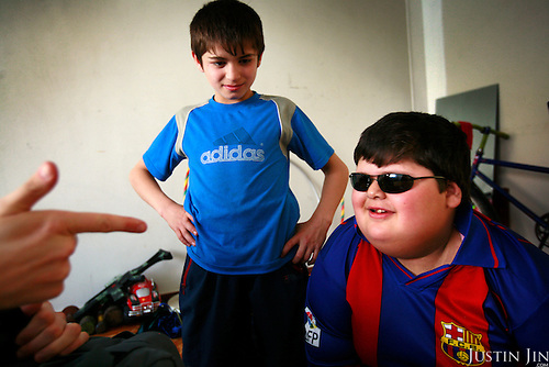Dzhambulat Khotokhov, 6, one of the fattest boys in the world, with his brother and a friend at home in Terek, in southern Russia. .Now 1.4 metres tall and weighing about 100 kg, Khotokhov has grabbed world attention as the biggest kid in the world since he was three. .Khotokhov lives with his mother Neyla and his brother, 14-year-old Mukha. .