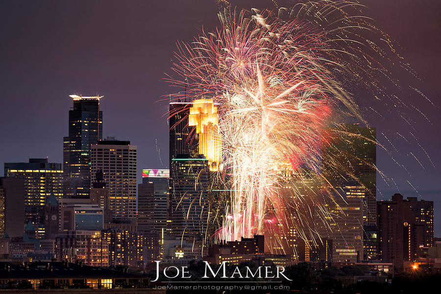 Minneapolis skyline with Aquatennial fireworks.