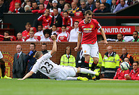 Pictured L-R: Gylfi Sigurdsson of Swansea tackling Phil Jones of Manchester United. Saturday 16 August 2014<br />