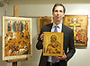 Russian Art Week <br /> Rare Russian Icons in London <br /> <br /> Jan Morsink Ikonen's Russian Icons: Spirit &amp; Beauty exhibition <br /> at Trinity House, Maddox Street, London, Great Britain <br /> press photocall<br /> 21st November 2014 <br /> <br /> <br /> Simon Morsink of Jan Morsink Ikonen from Amsterdam, Holland with a miniature Russian triptych icon depicting St Nicholas - scenes from his life - birth to death - it is valued at &euro;12,500 <br /> <br /> with various icons including the Royal Doors - two panels at the centre of the iconostasis and connect the nave with the sanitary in the Russian Orthodox Church. <br /> <br /> Photograph by Elliott Franks <br /> Image licensed to Elliott Franks Photography Services