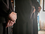 Hands of the faithful, First Monastic Liturgy, St. Silhouan Monastery, Columbia, California.
