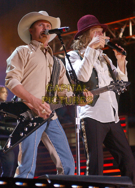 JOHN RICH & BIG KENNY OF BIG & RICH.2007 CMA Music Festival held at LP Field,Nashville, Tennessee, USA, 10  June 2007..half length country concert performing live on stage  hat guitar.CAP/ADM/LF.©Laura Farr/AdMedia/Capital Pictures.