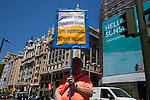 A man holds a banner against spanish monarchy at a Madrid street decorated with spanish flags the day before Felipe VI coronation as Spain´s King in Madrid, Spain. June 17, 2013. (ALTERPHOTOS/Victor Blanco)