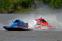 Frame 8: Chris Hughes, (#17) and Mark Schmerbach, (#35) come together in the first turn.    (SST-45 class)