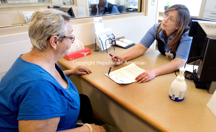 WATERBURY CT. 08 May 2015-050815SV07-From left, Kathy Johnson of Waterbury registers with Laurie Cahill, a patient access representative, at St. Mary&rsquo;s Hospital in Waterbury Friday. <br /> Steven Valenti Republican-American
