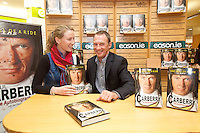 NO REPRO FEE.8/10/2011. Eason, Ireland's leading retailer of books, stationery, magazines and lots more, hosted a book signing by Jockey, Paul Carberry.  Pictured at Eason, O'Connell Street, Dublin is Elisabeth Looker from Longford and Paul Carberry who signed copies of his new autobiography One Hell of a Ride. Follow Eason on Twitter - @easons For further information, please contact: Aoife McDonald WHPR 087 4100777 . Picture James Horan/Collins Photos