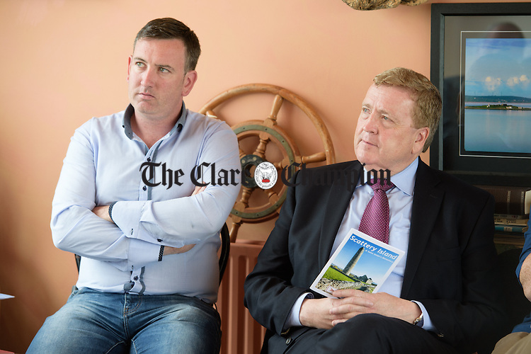Ian Lynch and Pat Breen TD Chairman Oireachtas Committee on Foreign Affairs and Trade at Kilrush Marina flanked by Simon Harris TD, Minister of State at the Departments of Finance, Public Expenditure and Reform. Photograph by John Kelly.