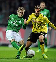 FUSSBALL   1. BUNDESLIGA   SAISON 2011/2012    9. SPIELTAG SV Werder Bremen - Borussia Dortmund                 14.10.2011 Chris Loewe (re, Dortmund) gegen Markus MARIN (li, Bremen)