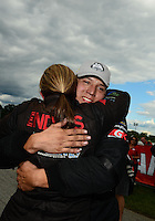 Sept 9, 2012; Clermont, IN, USA: NHRA pro stock driver Dave Connolly is congratulated by teammate and runner-up Erica Enders after winning the US Nationals at Lucas Oil Raceway. Mandatory Credit: Mark J. Rebilas-