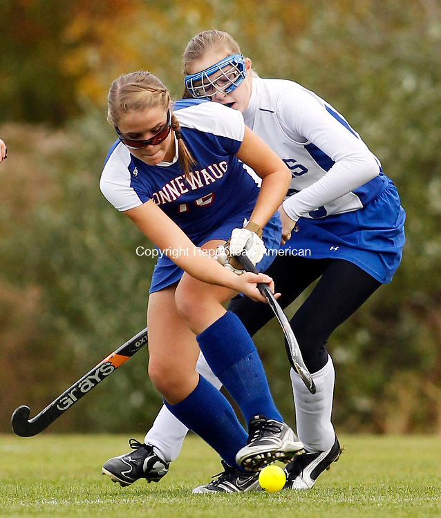 Burlington, CT- 18, October 2010-101810CM04  Nonnewaug's Alexa Brazauskas (front) and Lewis Mills' Mariah McCann battle for the ball during Berkshire Field Hockey action Monday afternoon in Burlington.  Nonnewaug blanked Mills 3-0, remaining undefeated on the season.  Christopher Massa Republican-American