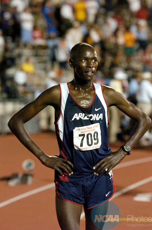 12 JUN 2004: Robert Cheseret (709) of Arizona recovers after running the 5000 meter race during the Division 1 Men's and Women's Outdoor Track and Field Championship held at the Mike A. Myers Stadium on the campus of the Universtiy of Texas at Austin in Austin, TX. Cheseret won the event with at time of 13:49.85.  Rich Clarkson/NCAA Photos