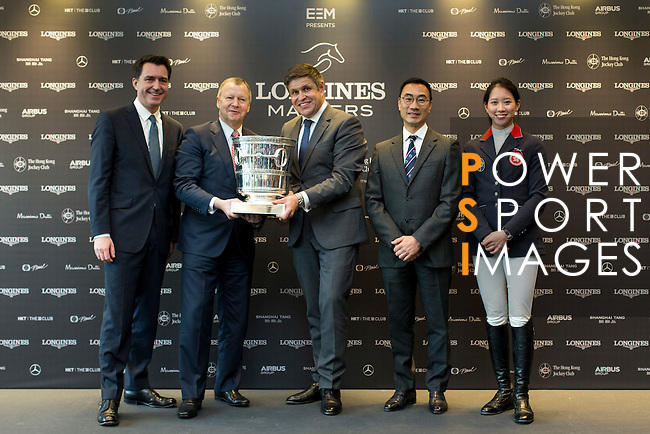 L-R: Fabien Grobon: Managing Director of EEM, Winfried Engelbrecht-Bresges, JP, CEO of The Hong Kong Jockey Club, Juan-Carlos Capelli, Vice-President and Head of International Marketing of Longines, Michael Lee, President of Hong Kong Equestrian Federation, and  Jacqueline Lai, Masters rider pose for a photograph with the trophy at Longines Hong Kong Masters official press conference at the Happy Valley Racetrack on February 02, 2016 in Hong Kong.  Photo by Victor Fraile / Power Sport Images