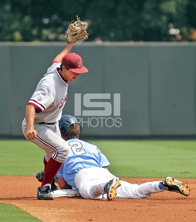 Kenny Diekroeger tags out UNC's Chaz Frank as he tried to advance to 2nd on a throwing error.