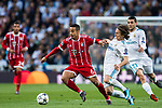 Thiago Alcantara (L) of FC Bayern Munich battles for the ball with Luka Modric of Real Madrid during the UEFA Champions League Semi-final 2nd leg match between Real Madrid and Bayern Munich at the Estadio Santiago Bernabeu on May 01 2018 in Madrid, Spain. Photo by Diego Souto / Power Sport Images