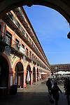 Historic buildings in Plaza de Corredera seventeenth century colonnaded square, Cordoba, Spain