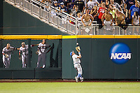 UCLA outfielder Christoph Bono (3) makes a running over the shoulder catch in the eighth inning against the North Carolina State Wolfpack during Game 8 of the 2013 Men's College World Series on June 18, 2013 at TD Ameritrade Park in Omaha, Nebraska. The Bruins defeated the Wolfpack 2-1, eliminating North Carolina State from the tournament. (Andrew Woolley/Four Seam Images)