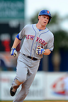 New York Mets second baseman Brian Bixler #16 runs the bases after hitting a home run during a Spring Training game against the Detroit Tigers at Joker Marchant Stadium on March 11, 2013 in Lakeland, Florida.  New York defeated Detroit 11-0.  (Mike Janes/Four Seam Images)