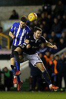 Sam Hutchinson of Sheffield Wednesday in an aerial challenge with Millwall's Ryan Leonard during Millwall vs Sheffield Wednesday, Sky Bet EFL Championship Football at The Den on 12th February 2019