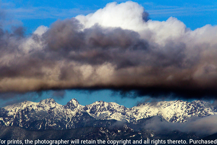 Clouds cover the Olympic mountains area in Washington's Olympic National Park. The Olympic Mountains is a year-round destination. In summer, visitors come for views of the Olympic Mountains, as well as for superb hiking.   ©2016. Jim Bryant Photo. All Rights Reserved.