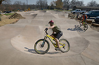 NWA Democrat-Gazette/BEN GOFF @NWABENGOFF<br /> Wes Wells of Bella Vista rides Sunday, March 19, 2017, at the new pump track at the Metfield Recreation Complex in Bella Vista. The poured concrete track, the first of it's kind in the area, was recently completed by Progressive Trail Design and is located next to a mountain bike skills course and acces to the Back 40 mountain bike trails.