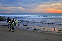 Two Local Surfers Checking Out The Waves At Sunset