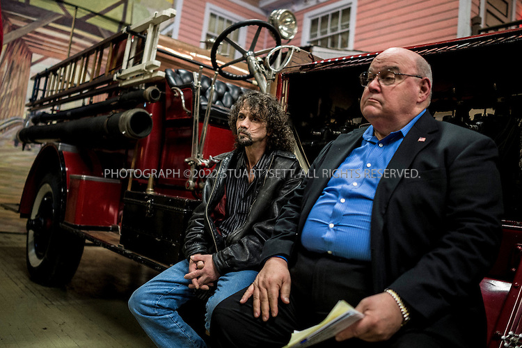 2/20/2014&mdash;Aberdeen, WA, USA<br /> <br /> Aaron Burckhart, 51 (left), Nirvana&rsquo;s first drummer sits with Aberdeen, Washington Mayor Bill Simpson at an event to unveil a statue of Cobain at the Aberdeen Museum of History. <br /> <br /> Despite referring to Cobain as a&rsquo;druggie&rsquo; several times, Mayor Young feels it is time for the city to embrace Cobain and his legacy. The event was held on what would have been Cobain&rsquo;s 47th birthday.<br /> <br /> Aberdeen, located in Grays Harbor County, near the Washington State coast,  is the birth place of rock legend Kurt Cobain, lead singer of Nirvana. Aberdeen and the neighboring town of Hoquiam, have had a difficult relationship with Cobain&rsquo;s legacy, with his drug use and suicide causing many in the community to believe he should not be honored. In recent years though, as the 20th anniversary of Cobain&rsquo;s death approaches and Nirvana is set to join the Rock and Roll Hall of Fame, a steady stream of tourists and travelers are coming to the town to see Cobain&rsquo;s childhood home and other sights. Many in Aberdeen &ndash; a place Cobain once mocked as &ldquo;Twin Peaks without the excitement&rdquo; &ndash;  are now embracing him and the city held its first annual Kurt Cobain Day on Thursday, February 20th, 2014.<br /> <br /> Aberdeen though, has fallen on hard times. With the slow death of the logging and fishing industries, its downtown is filled with abandoned shops, storefront churches and a steady stream of drug addicts, homeless kids and prostitutes. Most cars pass through the city&rsquo;s main street, Wishkah Street, without stopping, heading to resort hotels and vacation homes on the Washington coast. Unemployment is high, many homes are falling down or abandoned.<br /> <br /> Photograph by Stuart Isett<br /> &copy;2014 Stuart Isett. All rights reserved.