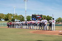 The Salt River Rafters during the National Anthem before the Arizona Fall League Championship game between the Salt River Rafters and the Peoria Javelinas at Scottsdale Stadium on November 17, 2018 in Scottsdale, Arizona. Peoria defeated Salt River 3-2 in extra innings. (Zachary Lucy/Four Seam Images)