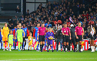 The Referee Andre Marriner and match officials lead the teams onto the pitch during the EPL - Premier League match between Crystal Palace and Liverpool at Selhurst Park, London, England on 29 October 2016. Photo by Steve McCarthy.
