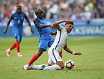 France's N'Golo Kante tussles with England's Alex Oxlade-Chamberlain during the Friendly match at Stade De France Stadium, Paris Picture date 13th June 2017. Picture credit should read: David Klein/Sportimage