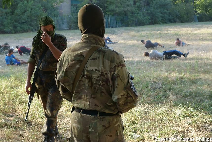 Training with Azov battalion, a volunteer militia, in Mariupol, Ukraine. September, 2014.