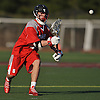 Matthew Farrell #4 of Syosset looks a pass into the webbing of his stick during a non-league varsity boys lacrosse game against host Garden City High School on Tuesday, Mar. 22, 2016. Syosset won by a score of 6-3.