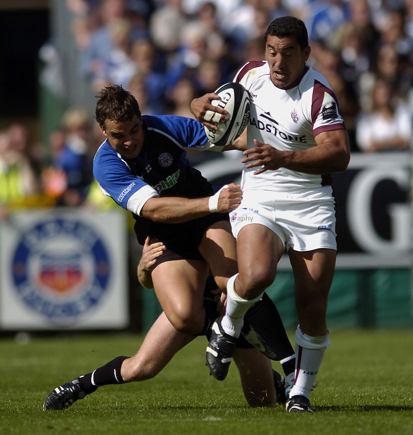 Photo: Jonathan Butler..Bath Rugby v Leicester Tigers. Guinness Premiership. 09/09/2006..Daryl Gibson of Leicester is tackled by Olly Barkley of Bath.