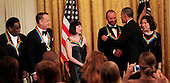 United States President Barack Obama hosts the reception for the  37th Kennedy Center Honorees in the East Room of the White House in Washington, D.C. on Sunday, December 7, 2014.  From left to right: Al Green,  Tom Hanks, Patricia McBride, Sting, President Obama, and Lily Tomlin.<br /> Credit: Dennis Brack / Pool via CNP