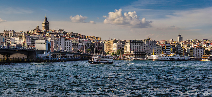Fine Art Landscape Photograph. <br /> The Bosphorus strait in Istanbul, Turkey. <br /> The golden rays of the setting sun add warmth and texture to the buildings and waterway of the Bosphorus.<br /> The golden sky background adds contrast, and brings out the beautiful architectural lines of the buildings and ships.