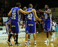 Kevin Owens and Ernest Scott congratulate Leon Henry on earning a penalty during the NBL Round 14 basketball match between the Wellington Saints and Auckland Stars at TSB Bank Arena, Wellington, New Zealand on Thursday 29 May 2008. Photo: Dave Lintott / lintottphoto.co.nz