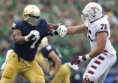 August 31, 2013:  Notre Dame defensive line Stephon Tuitt (7) and Temple offensive lineman Cody Booth (76) battle at the line in the first quarter of NCAA Football game action between the Notre Dame Fighting Irish and the Temple Owls at Notre Dame Stadium in South Bend, Indiana.  Notre Dame defeated Temple 28-6.