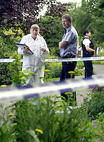 Scenes of crime officer in a white suit dusting for fingerprints after an incident took place in a park. Two men were fighting over a can of beer and one stabbed the other and ran off. The SOCO is taking detailed noted and is talking to a police officer. In the background is a female police officer who is wearing body armour. The area has been cordoned off with police barrier tape...© SHOUT. THIS PICTURE MUST ONLY BE USED TO ILLUSTRATE THE EMERGENCY SERVICES IN A POSITIVE MANNER. CONTACT JOHN CALLAN. Exact date unknown.john@shoutpictures.com.www.shoutpictures.com...