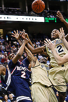 February 03, 2011:    Jacksonville Dolphins center Glenn Powell (42) and guard Travis Cohn (1) go up for a rebound over Belmont Bruins forward Blake Jenkins (2) during Atlantic Sun Conference action between the Jacksonville Dolphins and the Belmont Bruins at Veterans Memorial Arena in Jacksonville, Florida.  Belmont defeated Jacksonville 76-70.