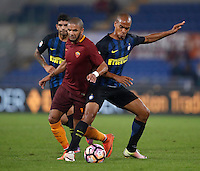 Calcio, Serie A: Roma vs Inter. Roma, stadio Olimpico, 2 ottobre 2016.<br /> Roma&rsquo;s Bruno Peres, left, and FC Inter&rsquo;s Joao Mario fight for the ball during the Italian Serie A football match between Roma and FC Inter at Rome's Olympic stadium, 2 October 2016.<br /> UPDATE IMAGES PRESS/Isabella Bonotto