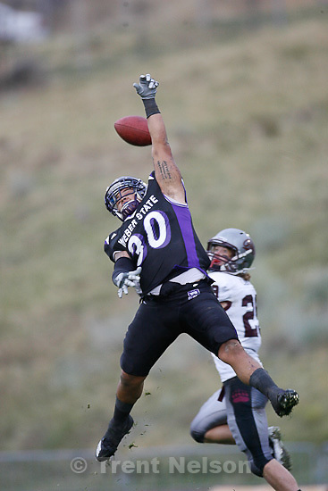 Trent Nelson  |  The Salt Lake Tribune.Weber State's Taylor Sedillo knocks the ball away from Montana receiver Bryce Carver during the second half, Weber State vs. Montana, college football Saturday, October 30, 2010.