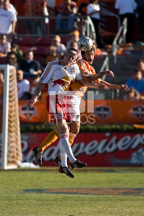 New York Red Bulls forward John Wolyniec (15) and Houston Dynamo defender Eddie Robinson (2) go up for the header.  New York Red Bulls defeated Houston Dynamo 3-0 for an aggregate  score of 4-1 over Houston Dynamo   at Robertson Stadium in Houston, TX on November 9, 2008 in the second leg of the Western Conference semifinals.  Photo by Wendy Larsen/isiphotos.com