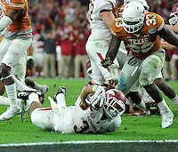 NWA Media/Michael Woods --12/29/2014-- w @NWAMICHAELW...University of Arkansas runnungback Jonathan Williams dives to the end zone as he runs the ball just short of the goal line to set up the Razorbacks last touchdown  during the 4th quarter of their 31-7 win over the University of Texas during the Texas Bowl Monday night at  NRG Stadium in Houston.