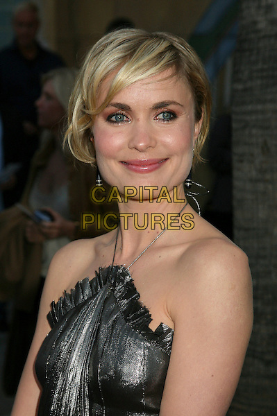 "RADHA MITCHELL.Los Angeles Premiere of ""Silent Hill"" at the Eqyptian Theater, Hollywood, California, USA,.20 April 2006..portrait headshot silver metallic dress halterneck.Ref: ADM/BP.www.capitalpictures.com.sales@capitalpictures.com.©Byron Purvis/AdMedia/Capital Pictures."