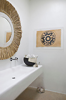 The bathroom is furnished with a long contemporary wash basin