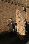 Straw Bear Festival. Whittlesea Whittlesey Cambridgeshire UK 2008. Straw Bear and handler.